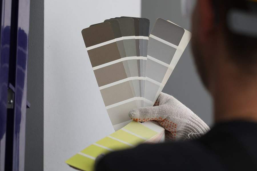 close up of man looking at potential pantone palette colours for home