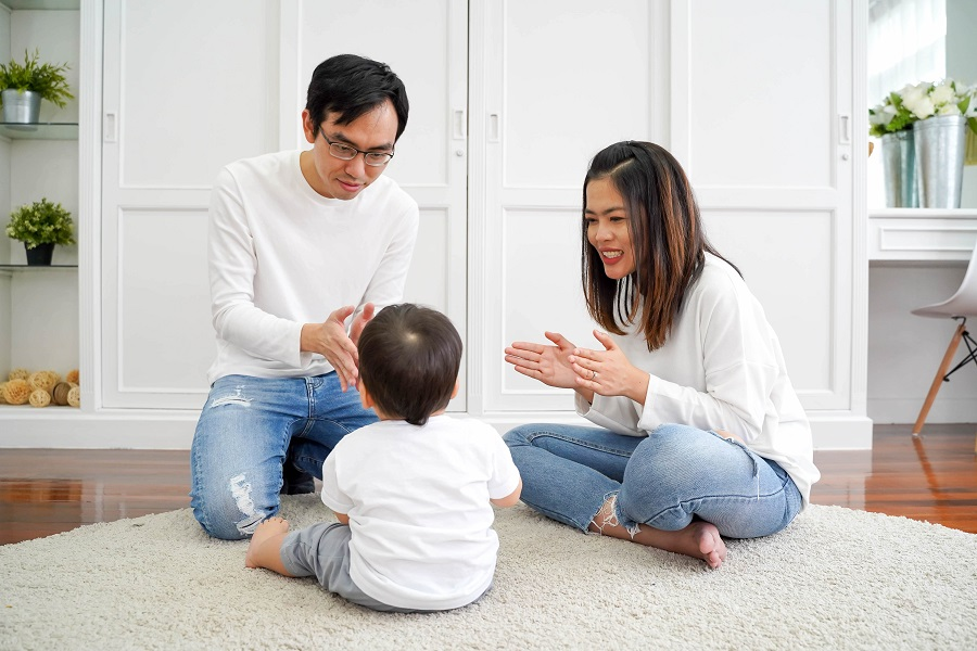 happy asian family spending time in clean interior design room