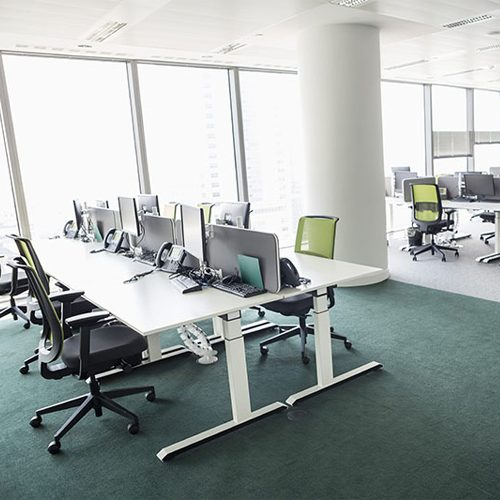 office interior design with lined up desks facing each other